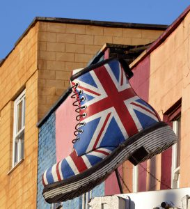 """London, UK - January, 9th 2013:A large boot decorated with the British flag on display above street level in the Camden Market area of LondonCamden market is well known for many of these large effigies on display above the shops and restaurants as it is a popular tourist area of London."""